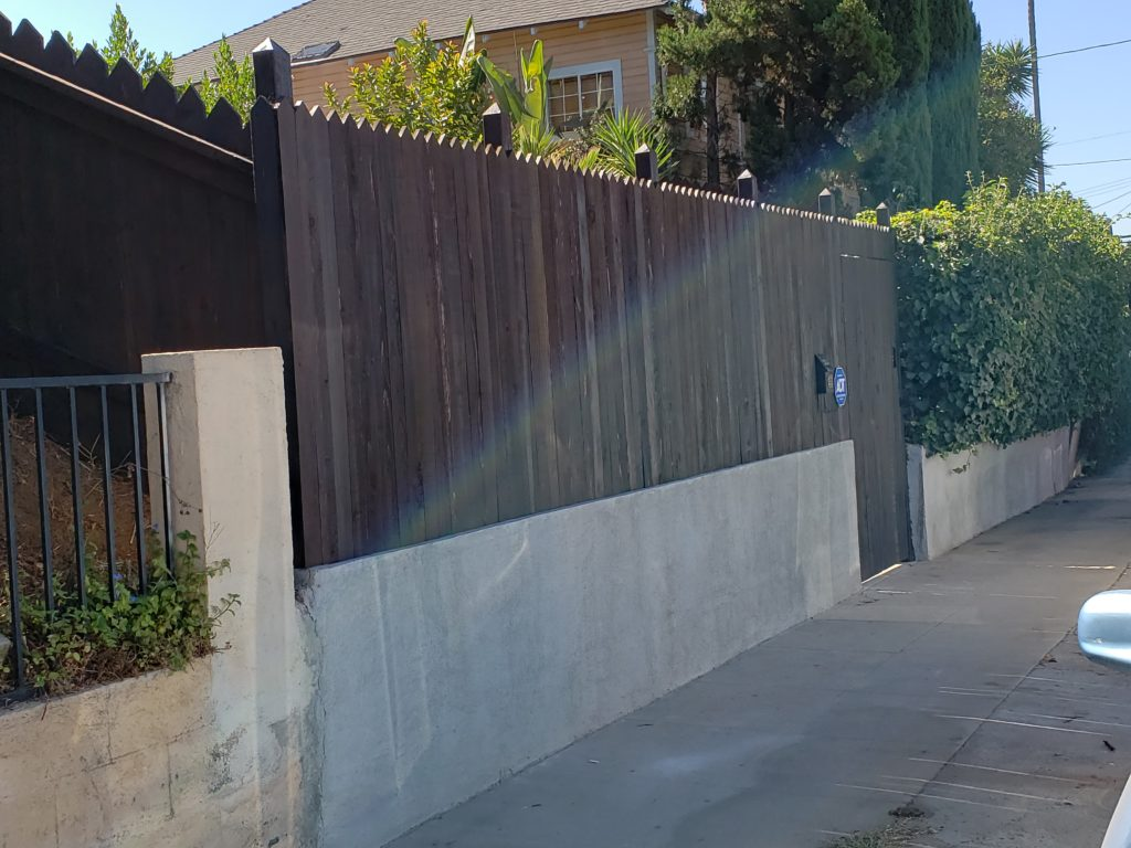 Custom Pointed Top Stained Front Yard Wood Fence + Entry Gate Portal, outside view, Los Angeles 90026, Built by WoodFenceExpert.com