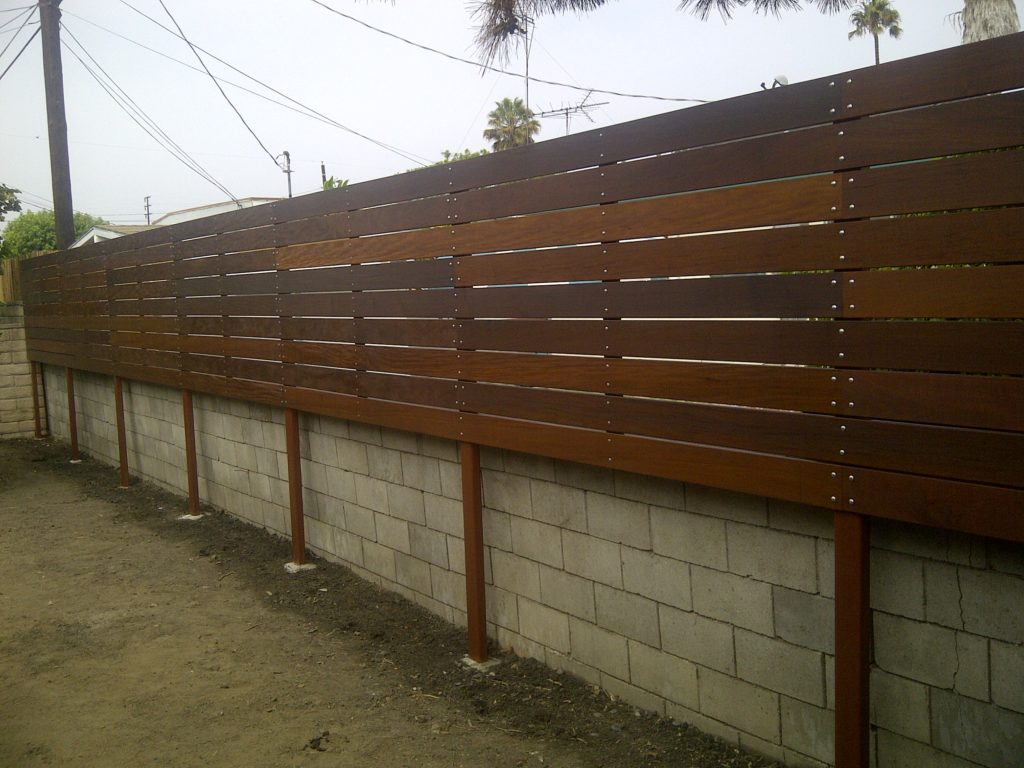 1x6 Ipe Elevated/Floating Horizontal Semi-privacy Fence 1 of 2, Built and stained by WoodFenceExpert.com