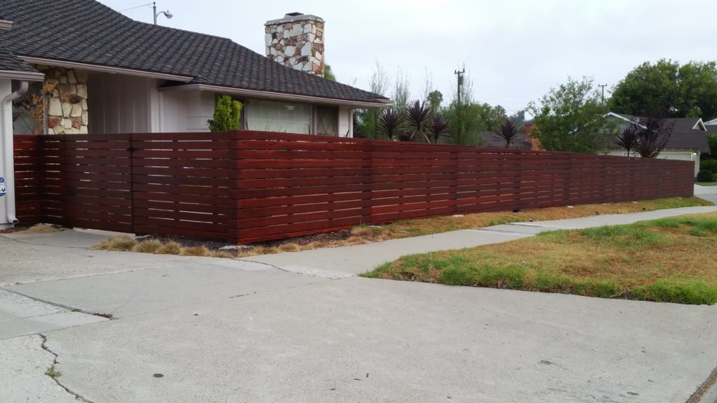 Front yard modern horizontal wood fence + matching pedestrian gate in Los Angeles, Built and stained by WoodFenceExpert.com #2