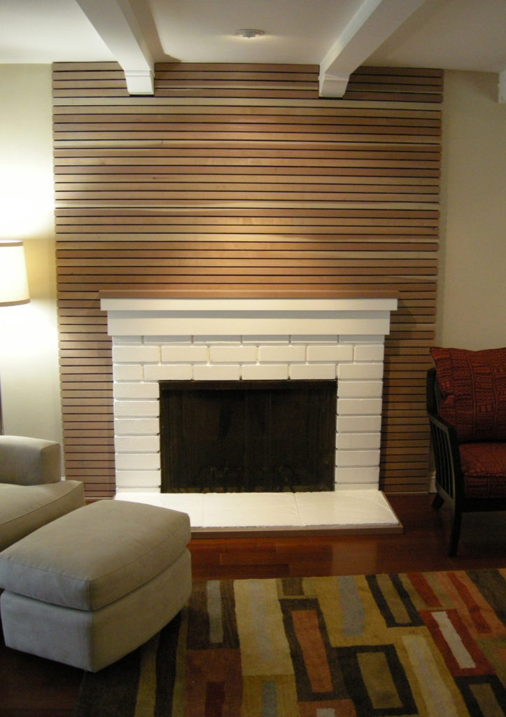 1x2 Horizontal Wall Facade in Living Room Surrounding Fireplace, Built by WoodFenceExpert.com
