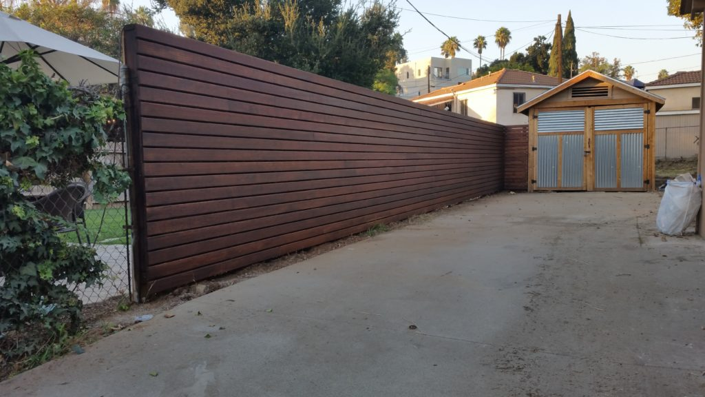Modern Horizontal Wood Fence along Driveway in Los Angeles, built and stained by WoodFenceExpert.com