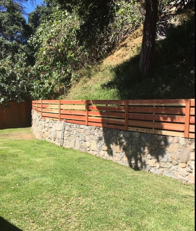 Modern Horizontal Wood Fence atop Pre-existing Stone Retaining Wall + Matching Gates 1 of 2, Built by WoodFenceExpert.com