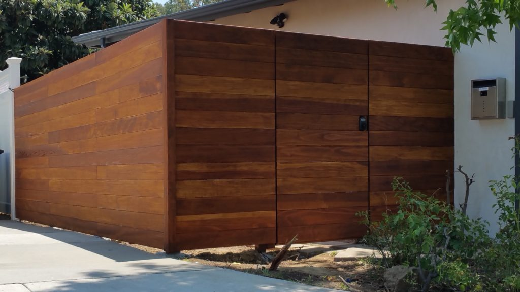 Modern Horizontal Wood Privacy Fence with Matching Pedestrian Gate in Los Angeles 91604, outside view, Built and stained by WoodFenceExpert.com