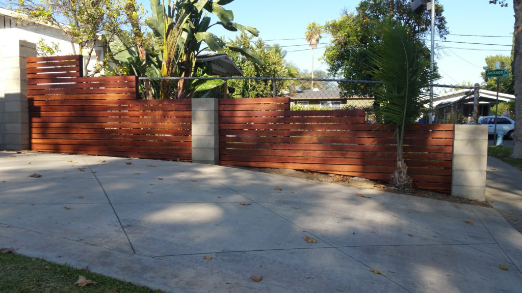 Modern Horizontal Wood fence built upon already existing concrete block pillars in Whittier, Built and Stained by WoodFenceExpert.com