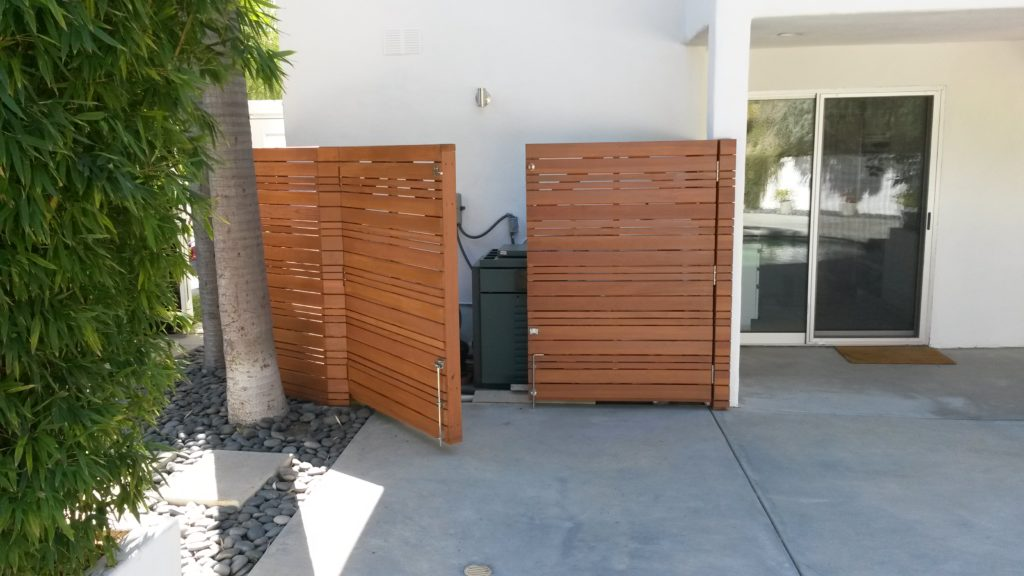 modern horizontal wood fence with a matching double-swinger pedestrian gate pool equipment enclosure, #2, built and stained by WoodFenceExpert.com