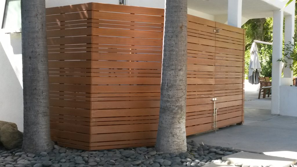 modern horizontal wood fence with a matching double-swinger pedestrian gate pool equipment enclosure, #3, built and stained by WoodFenceExpert.com