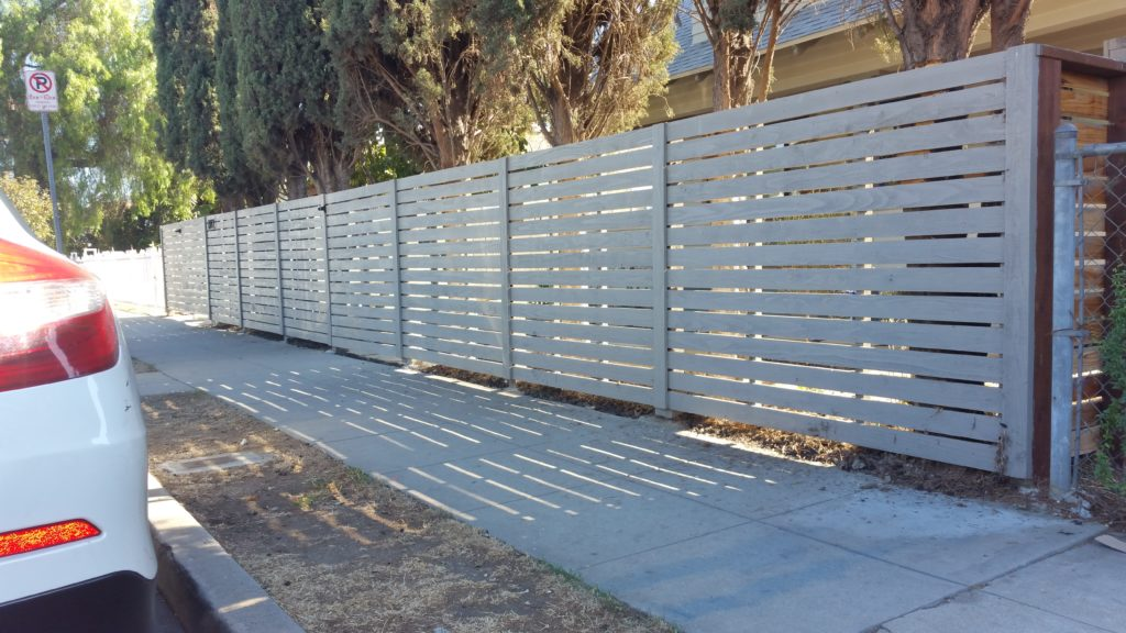 modern horizontal wood fence with matching pedestrian and double-swinger driveway gates in Los Angeles, 1 of 9, built and painted by WoodFenceExpert.com