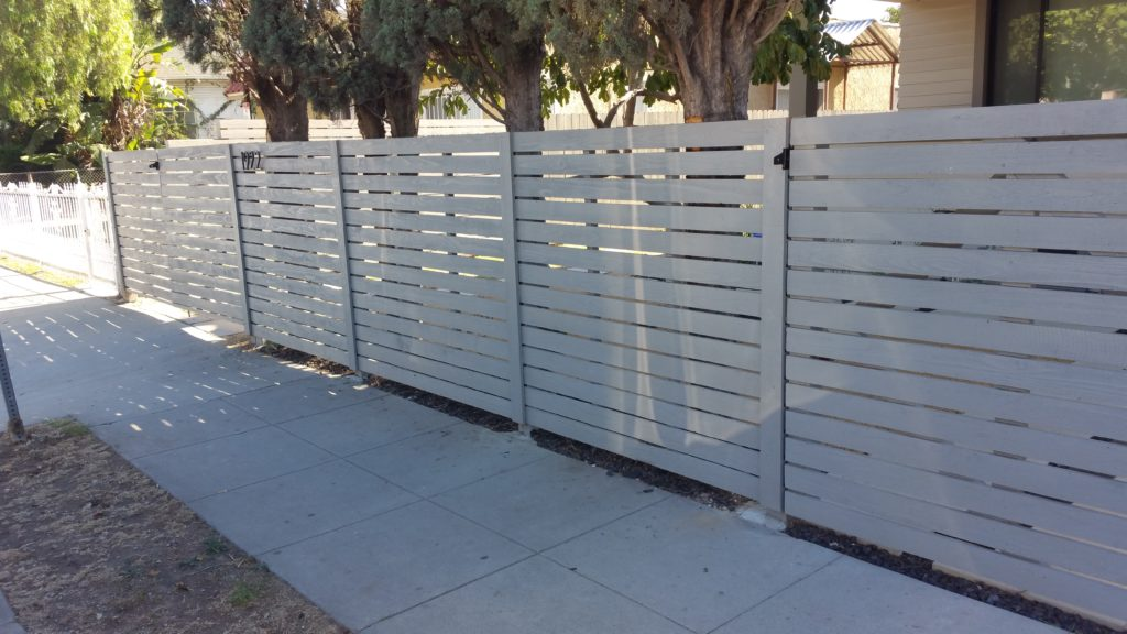 modern horizontal wood fence with matching pedestrian and double-swinger driveway gates in Los Angeles, 2 of 9, built and painted by WoodFenceExpert.com